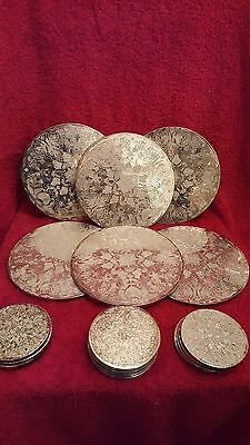 A silver plate  collection of 6 vintage dinner mats and 14 silver plate coasters