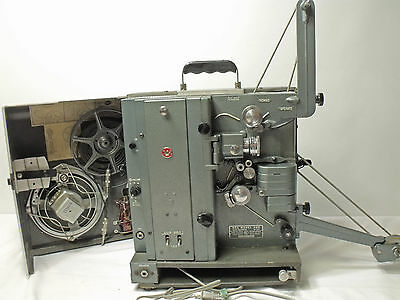 Vintage RCA Model 400 16mm Film Projector w/ cover & operating accessories.
