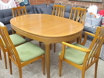 extending dining  room table and six chairs