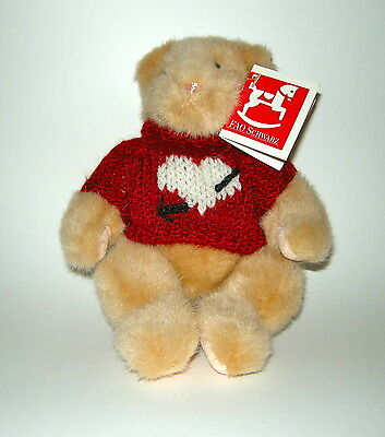 "FAO SCHWARTZ TEDDY BEAR 9"" Tan, pink nose, in sweetheart sweater. Has tags on."
