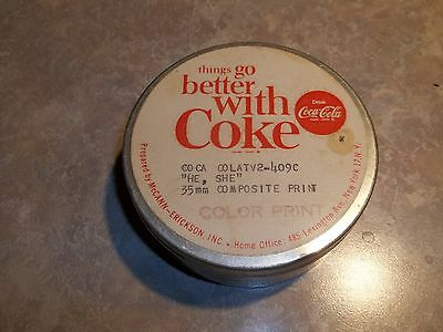 Coca Cola Flim Cannaster with 16 NOS Bottle Tops 12 different 5 are cork lined