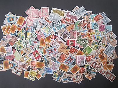 Vietnam off paper  200 + estimated Mint and Used stamps with duplication