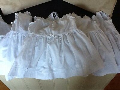 Five Vintage Child's White Slips With Lace Detail And Drawstring Fastenings