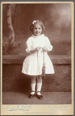 excellent Victorian cabinet card of girl and her string toy