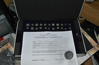 22 uncleaned roman coins in a case