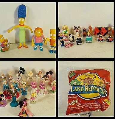 90s misc toy lot. Most McDonald toys. barbie. simpsons. peter pan. dinsey.