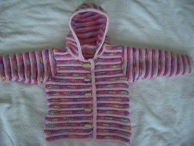 Baby's hand knitted hooded jacket in pale pink and sunrise