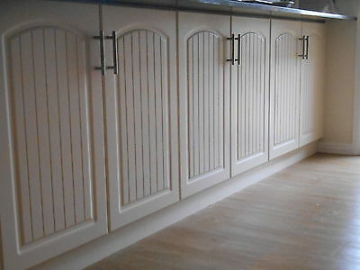 Kitchen Cabinet Door and Drawer fronts in Antique White Vinyl Wrapped.