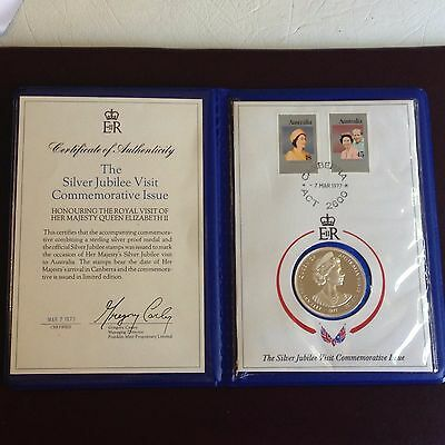 1977 Silver Jubilee Visit Coronation Medal in card with 2 Stamps in a folder