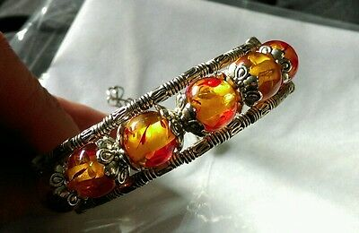 vintage look silver tone bracelet with Amber colour beads