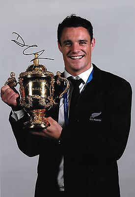 dan carter new zealand with world cup trophy signed 12x8 photo