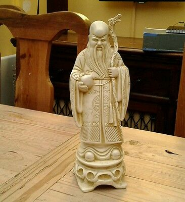 carved chinese wise man figure signed