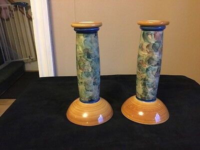 pair of jersey pottery candlesticks