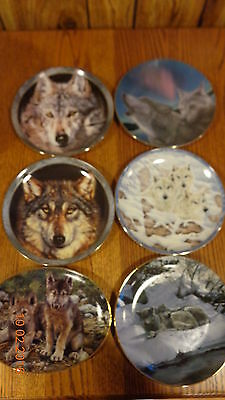 7 wolf plates from Bradford Exchange in original box's with COA.