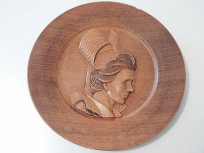 Good signed carved wooden plaque featuring a woman's head