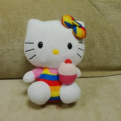 Ty Hello Kitty collectible plush toy wearing a striped suit & holding a cup cake