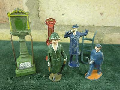 A small job lot of vintage lead railway station items and figures