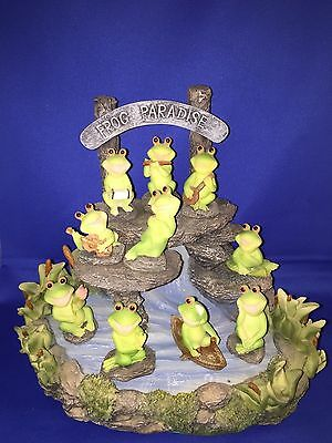 FROG PARADISE stand and 9  FROGS MADE OF RESIN