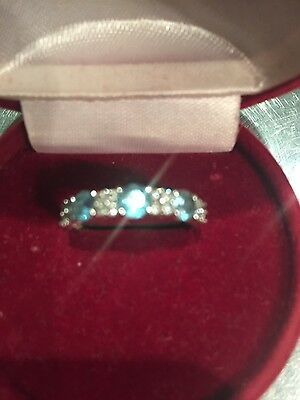 1/4 diamonds and topaz eternity ring size M set in 9 ct white gold from F. Hinds