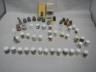 Eclectic collection of 56 thimbles in metal, pewter, bone china, ceramics and gl