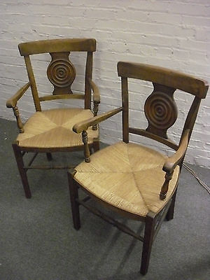 Pair of Vintage Cane Seat Armed Medallion Chairs