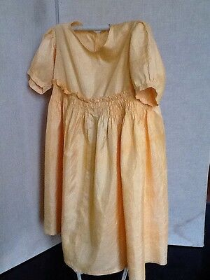 Vintage Child's Dress In Soft Apricot Silk With Smocking Detail
