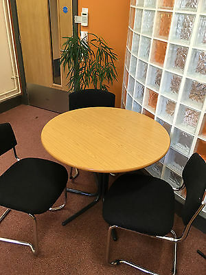 Round Office meeting table with 3 dark charcoal grey stackable chairs