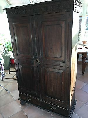 Antique oak cupboard. Lovely carvings and two little drawers. Charming item.