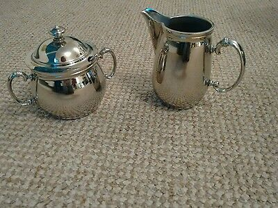 silver plated milk and sugar bowl with lid&spoon.