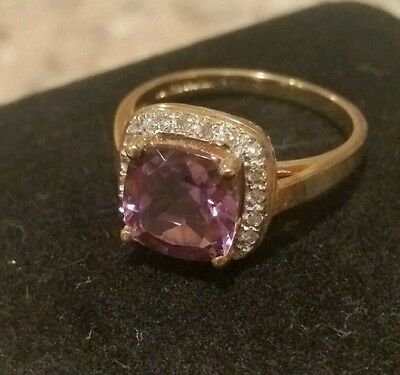 14k yellow gold cushion cut Amethyst and 1/10 ct tw Diamond ring, size 6