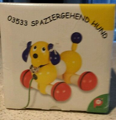 Pintoy wooden pull along dog