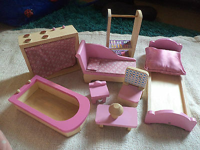 selection of wooden dolls house furniture