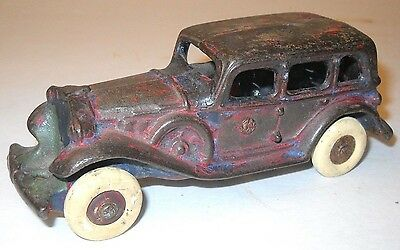 Vintage Red Cast Iron Sedan With White Rubber Wheels