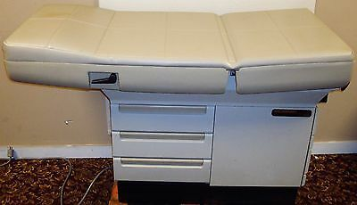 Midmark 404 Medical Exam Table with Stirrups and Good Upholstery