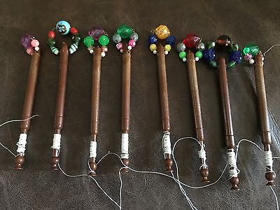 Eight turned wood Lace making bobbins with colourful Spangles. Lovely