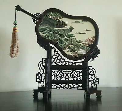 Oriental silk reversable picture with hand carved stand