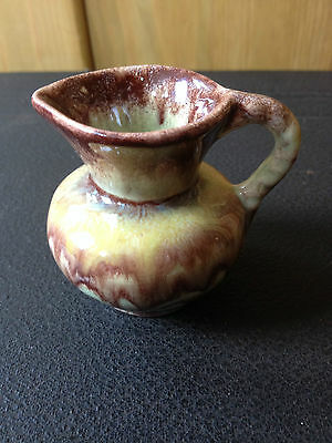 Pottery Jug In Brown Colours
