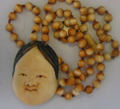Vintage Japanese Hand Carved Okame Mask Pendant and Bead Necklace. Signed