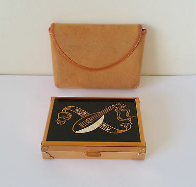 collectable mid century Agme musical compact powder case made in Switzerland