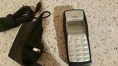 Nokia 1100 phone with charger