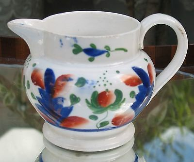Antique : a 19th century pottery Gaudy Welsh Jug
