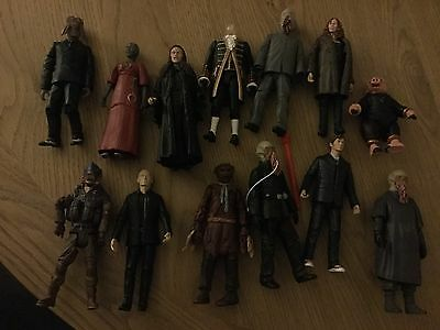 13 Dr Who collectable figures.