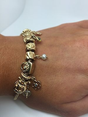 pandora 14ct gold bracelet with 9 jewelled charms