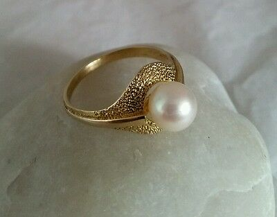 A vintage 9ct Yellow Gold Ring. Set with a Cultured pearl . London 1970