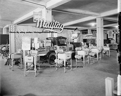 Photo of Antique Maytag Wringer Washing Machines and a Model T Roadster Truck