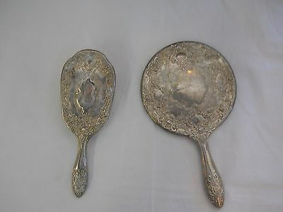 antique Sterling silver hand mirror and matching brush