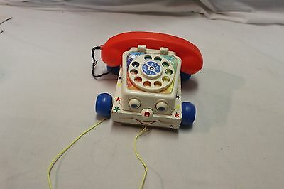 Vintage Fisher Price Chatter Telephone 747. Wood base, pull string