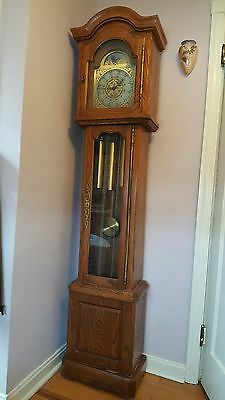 Daneker Diplomat Grandfather clock. Oak.