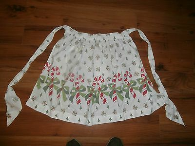 vintage christmas apron with candy canes and green bows and pocket