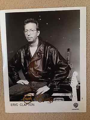 Reduced - Genuine Eric Clapton signed photograph in gold